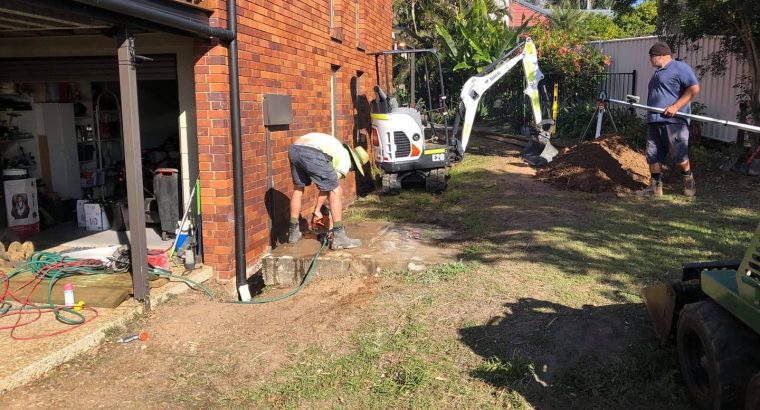 Retaining, turfing, fencing, concreting and new side entrance.