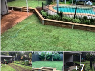 Retaining wall with steps and a full returf.
